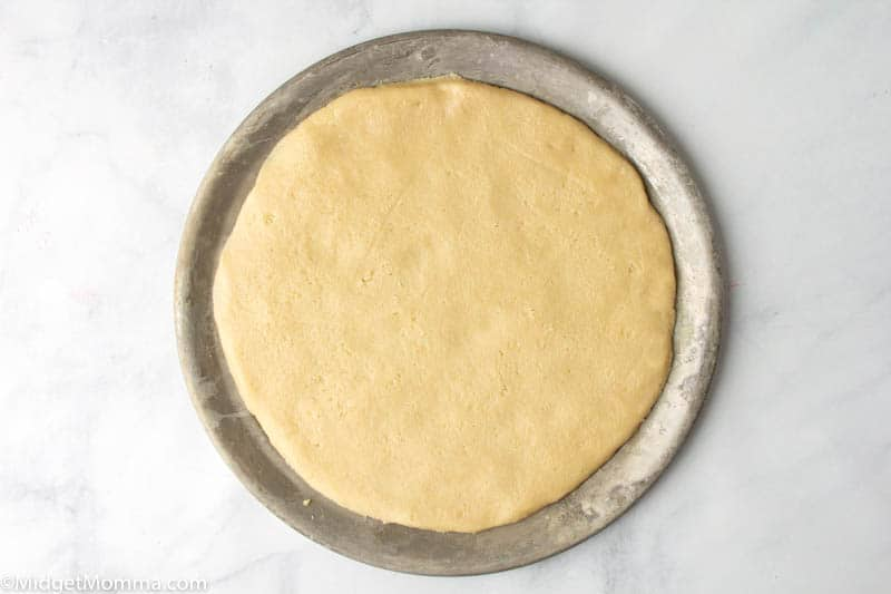 sugar cookie dough on a pizza pan