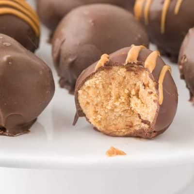 close up photo of Peanut Butter Balls with a bite taken out of one