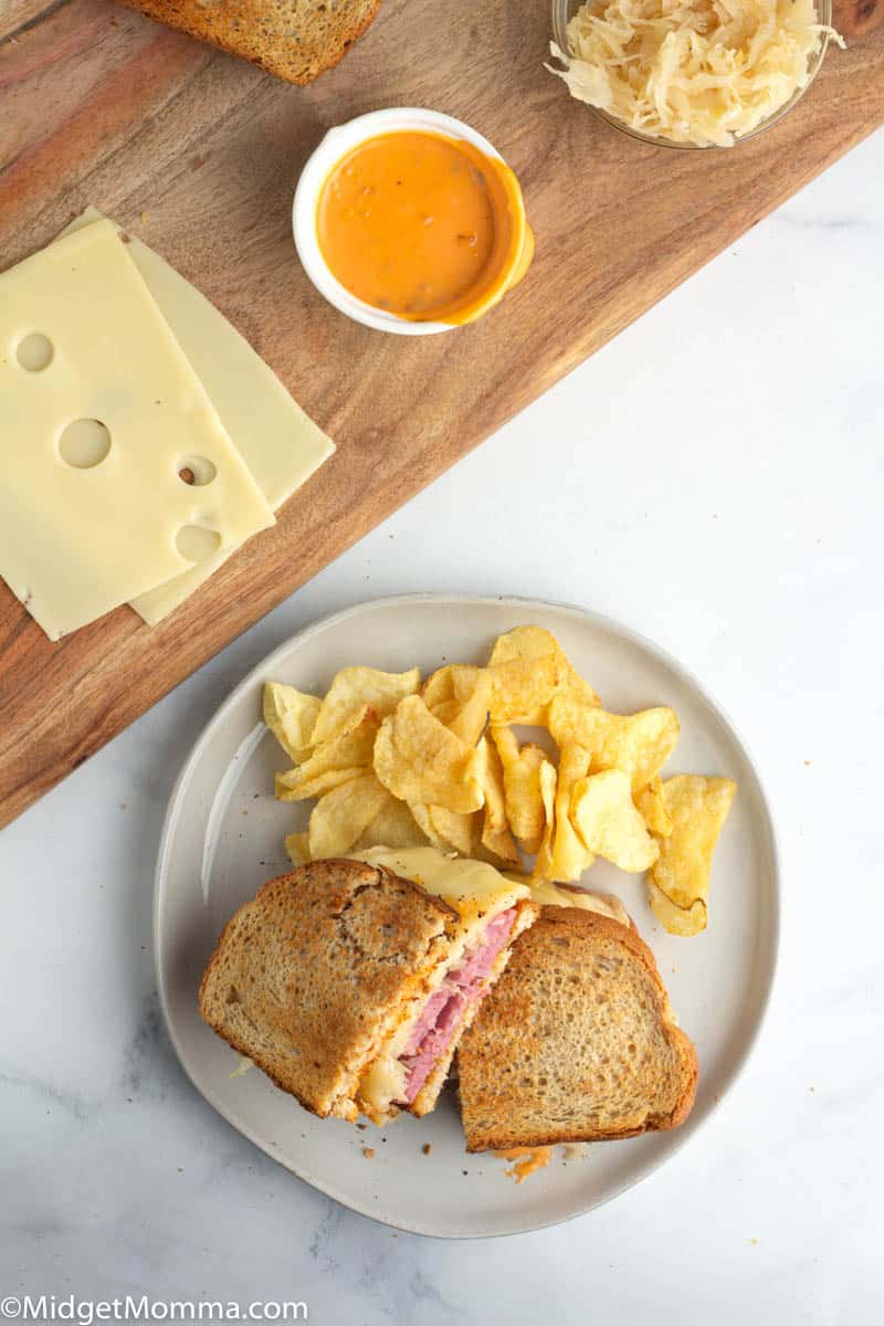 Reuben Sandwich on a plate with chips
