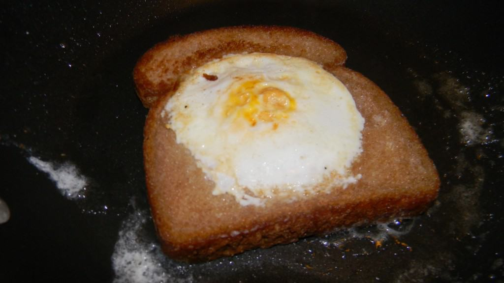 An egg in a hole is a egg that has been pan fried in a slice of bread. When you break it open the bread starts to soak up all the yolk.