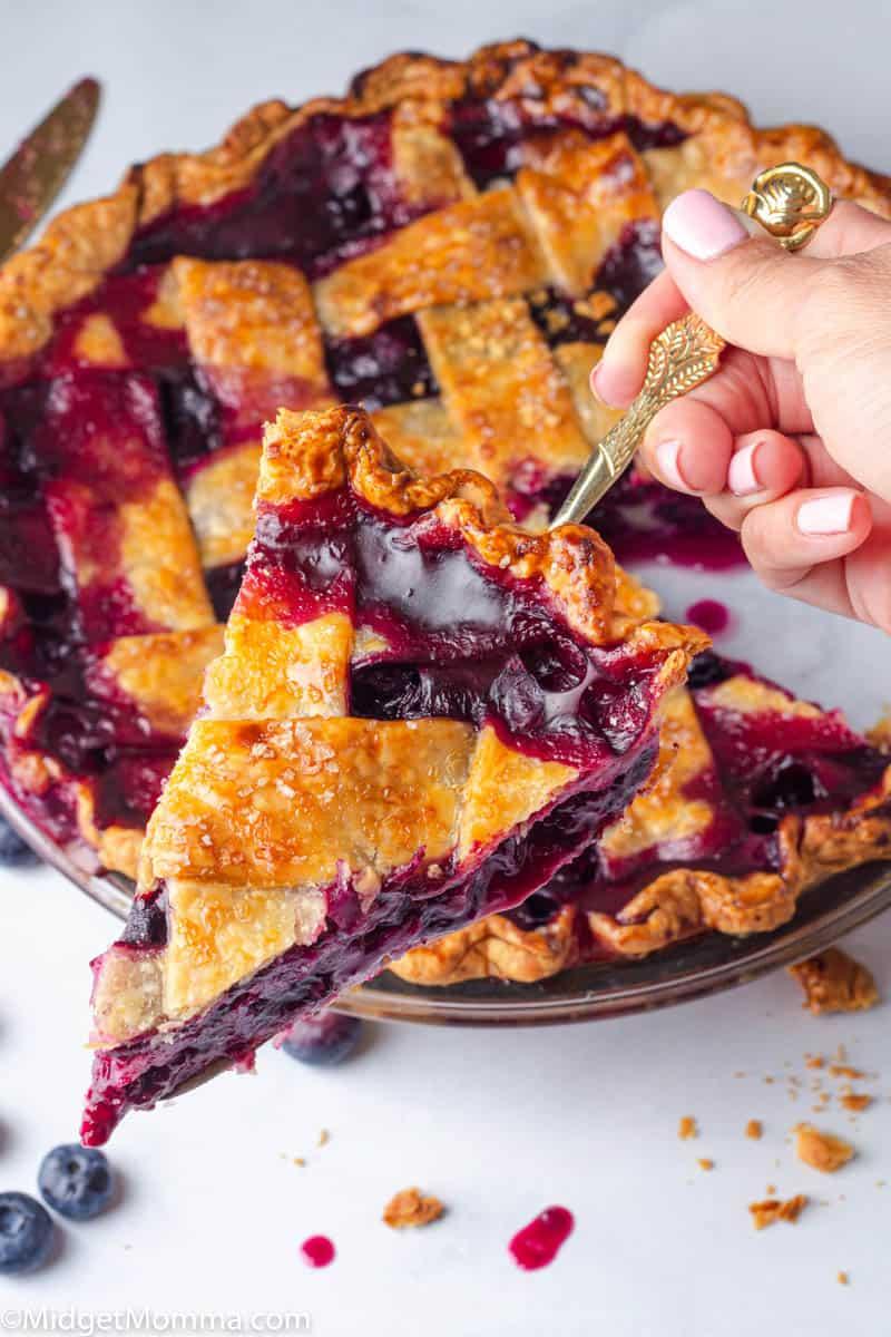 Slice of homemade blueberry pie on a serving utensil