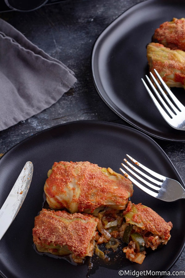 Crock pot stuffed cabbage rolls recipe cooked set on a black plate