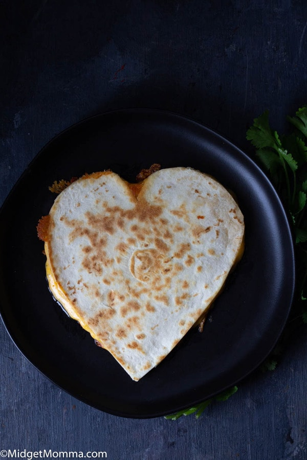 How to make a heart shaped quesadilla - heart shaped quesadilla on a black plate