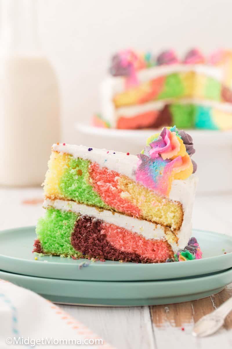 slice of rainbow cake on a plate