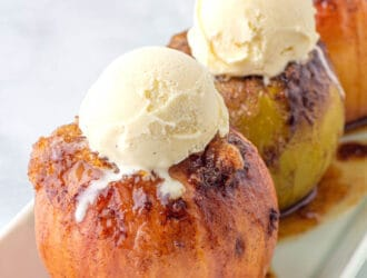 Baked Apples- on a white serving platter topped with vanilla ice cream