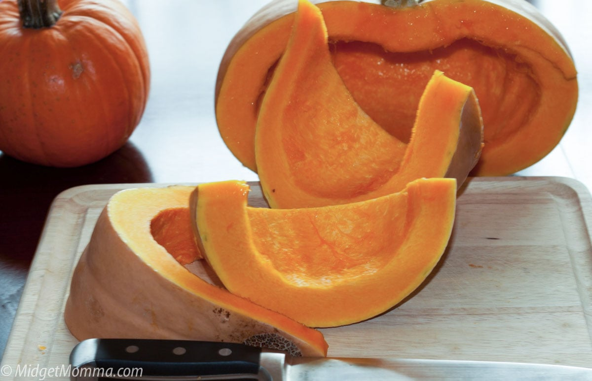 cutting uncooked pumpkin into wedges
