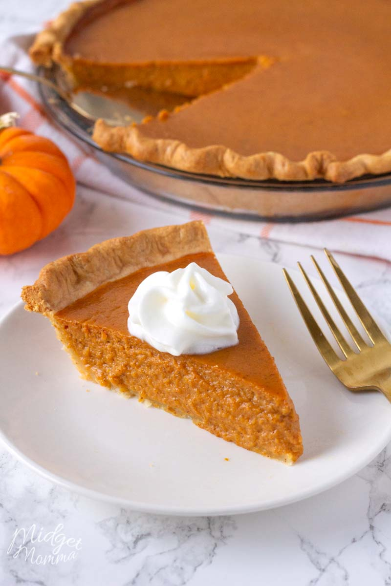 pumpkin pie made with fresh pumpkin topped with a dolup of whipped cream