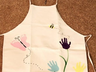 Garden Of Love Apron with Painted Kids hands and feet