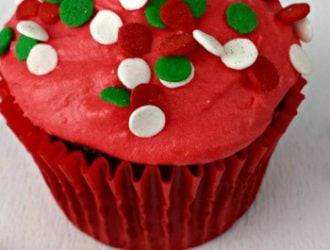 Chocolate Holiday Cupcakes are a chocolate lovers cupcake topped with this vanilla buttercream. It is made festive with fun Christmas sprinkles.