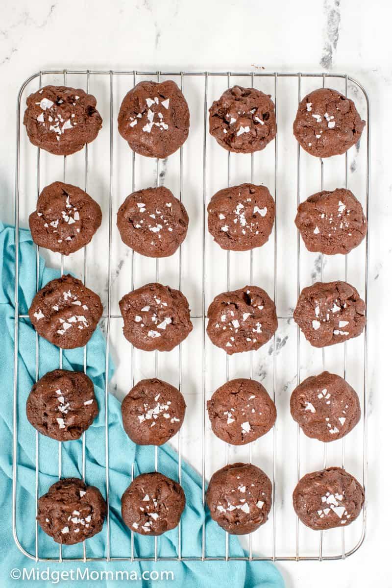 caramel stuffed chocolate cookies cooling on a baking sheet