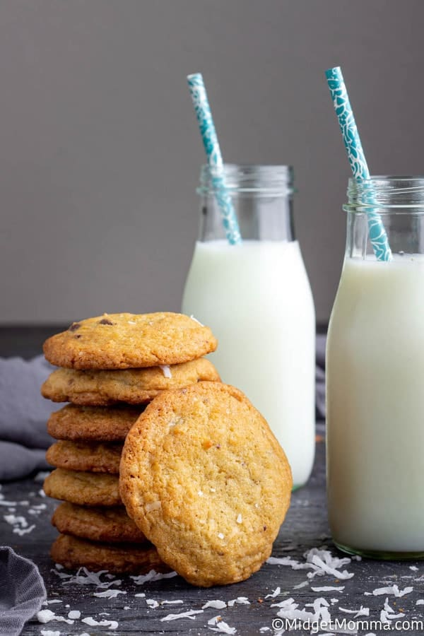 coconut chocolate chip cookies recipe - baked and cooled cookies in a stack with a glass of milk