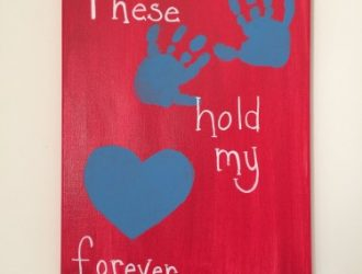 Homemade Valentine Hand Sign With Kids hands