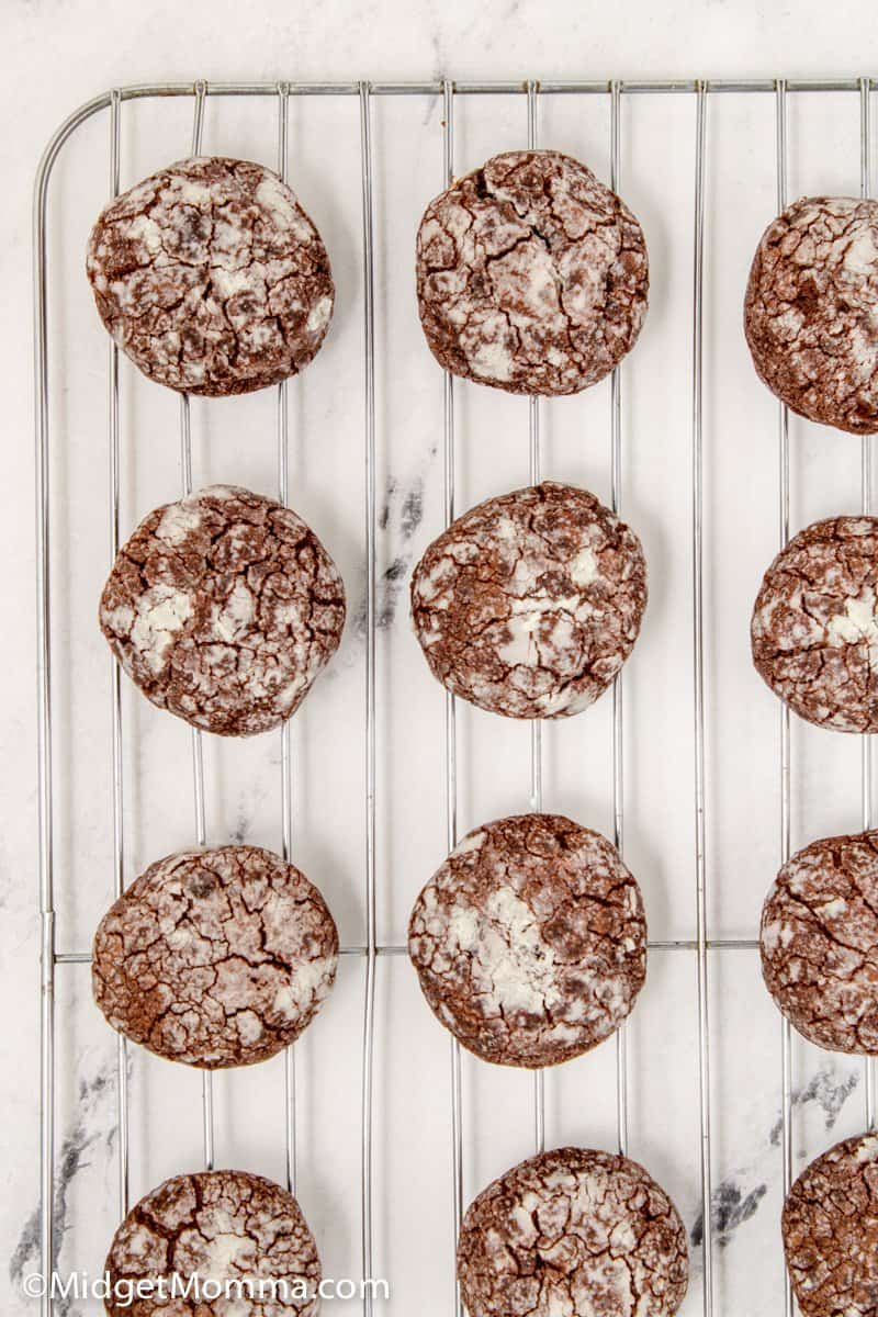 Chocolate Crackle Cookies cooling on a baking rack