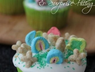 Lucky Charms Cupcakes with Marshmallow Icing are full of fun with a great surprise filling. . They are festive for St. Patrick's day.