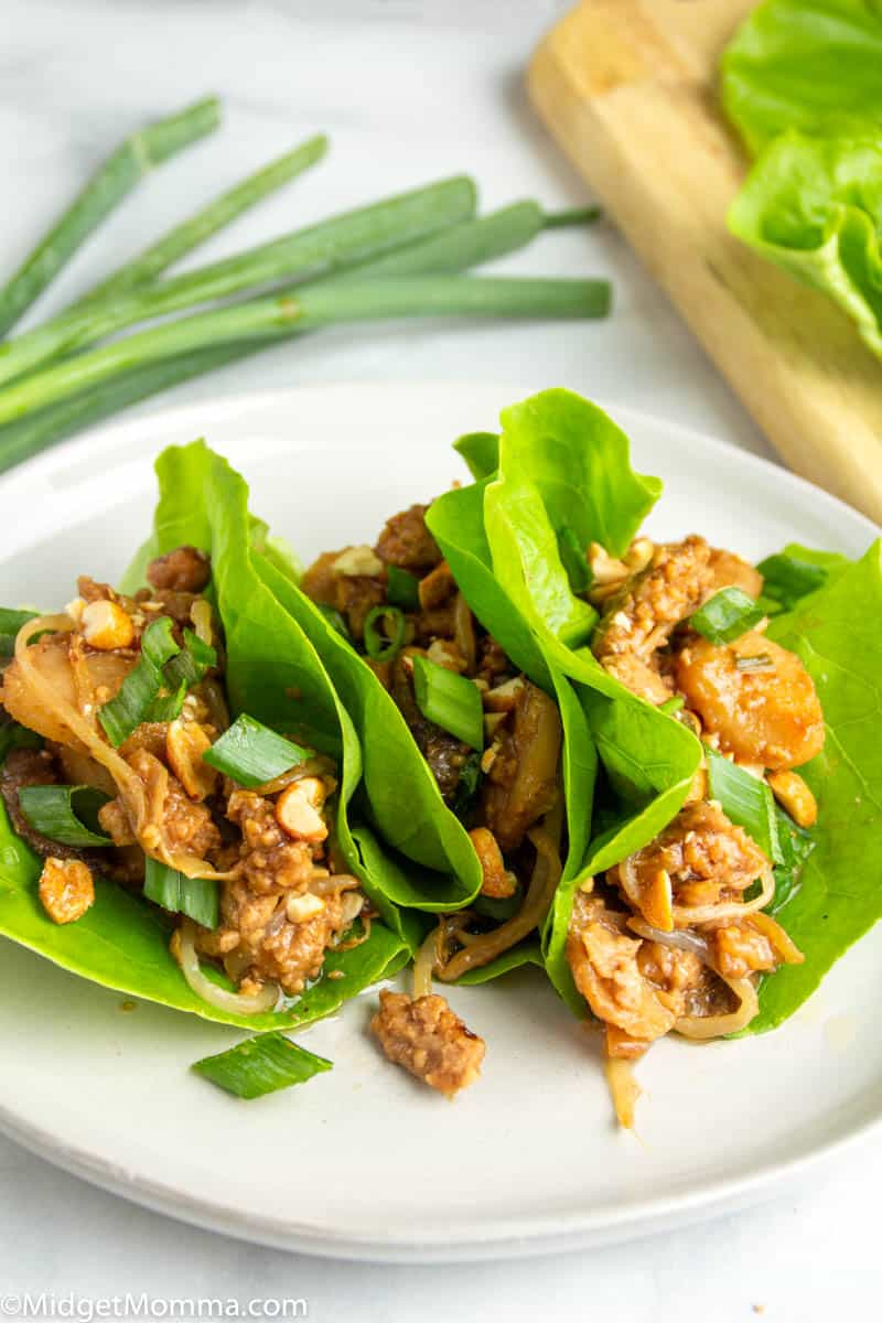 2 Asian Chicken lettuce wraps on a plate