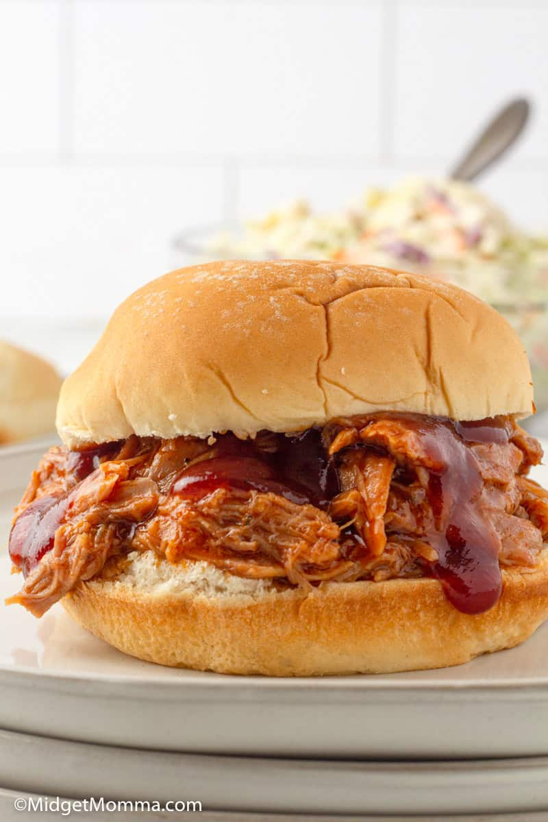 slow cooker pulled pork sandwich on a plate