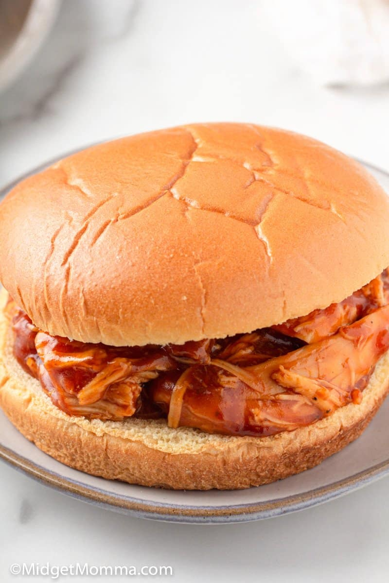 Slow Cooker Barbecue Pulled Chicken on a bun close up shot