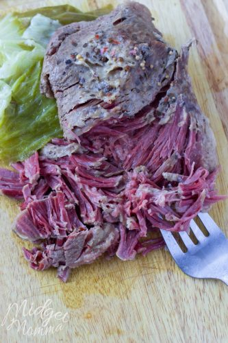 crockpot corned beef and cabbage cooling on a cutting board