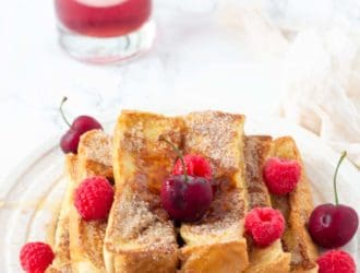This easy homemade french toast stick recipe is the perfect breakfast. Once you make these Cinnamon and Sugar Homemade French Toast Sticks you will never want to eat frozen french toast sticks again! I have been told these easy french toast sticks taste just like cinnamon and sugar doughnuts!