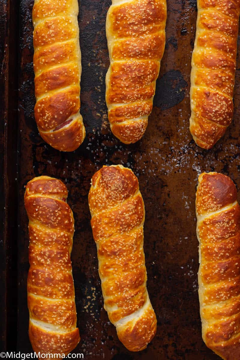 pretzel dogs on a baking sheet out of the oven