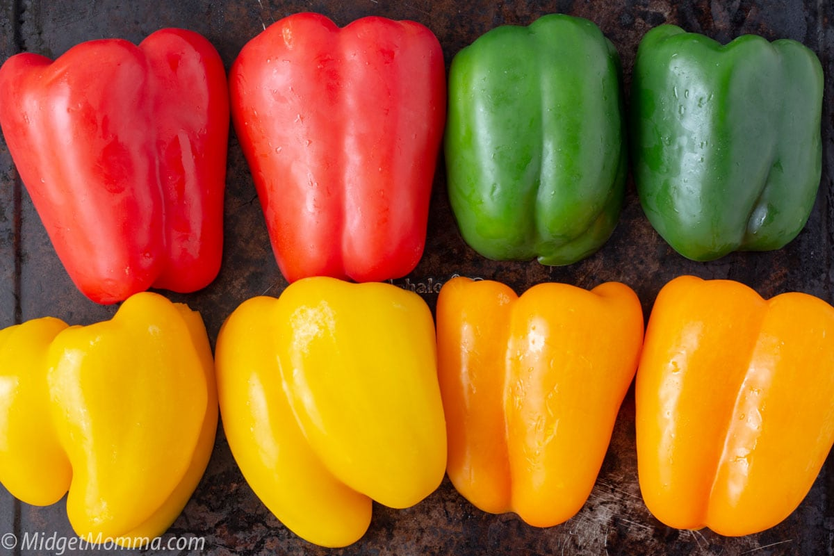 How to Roast Peppers - fresh peppers on a baking sheet