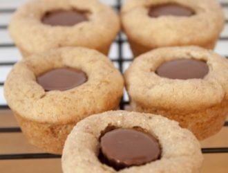 Peanut Butter Blossom Cup made with homemade peanut butter cookies and peanut butter cups. Its a fun twist on the classic cookie.