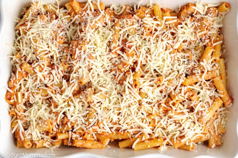 ingredients topped with cheese in baking dish