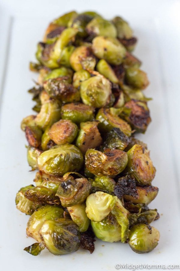 Oven Roasted Brussel Sprouts on a white serving dish