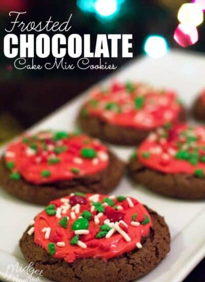 Fresh baked chocolate cake cookies with red frosting and christmas sprinkles