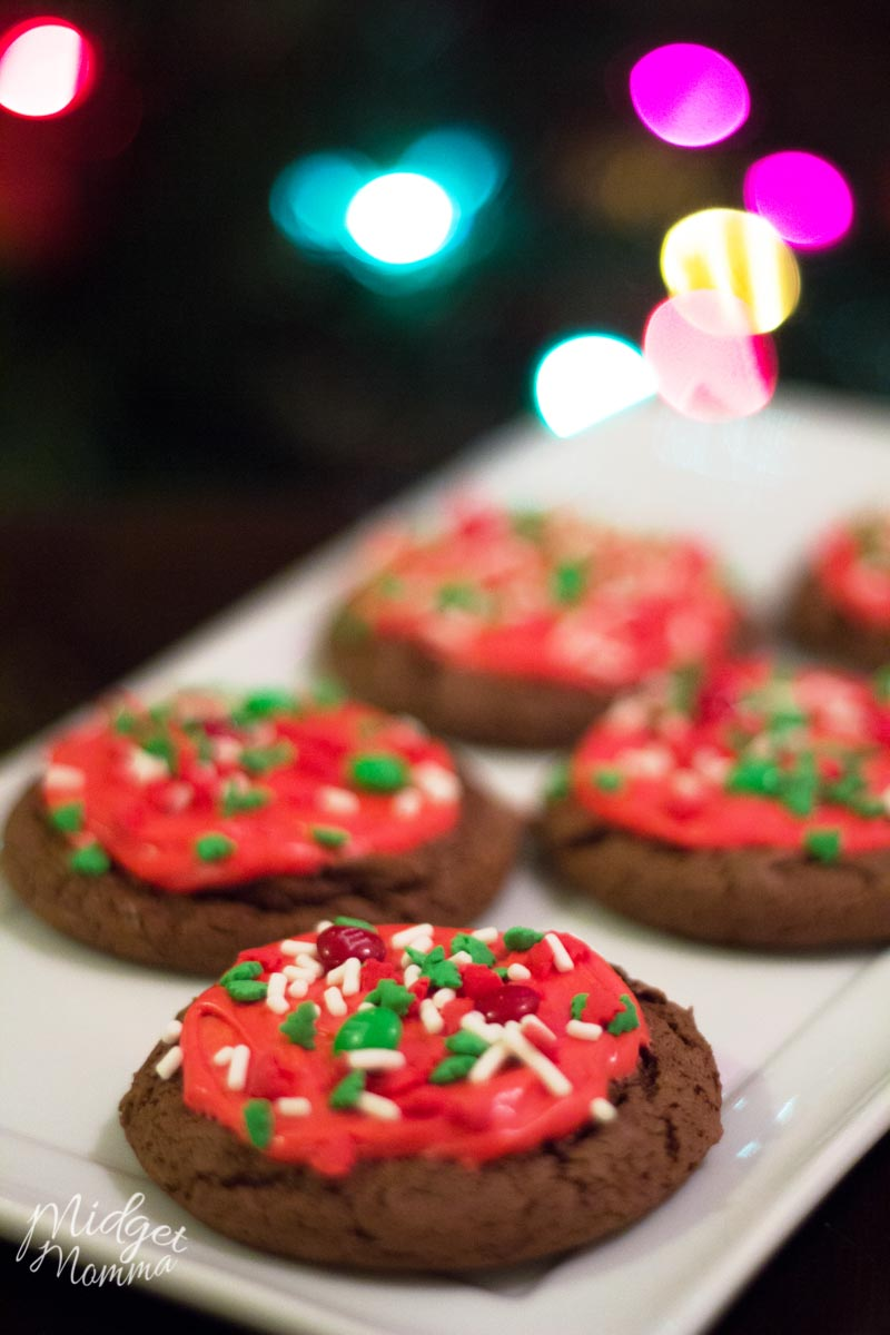 Chocolate cookies with red frosting and sprinkles