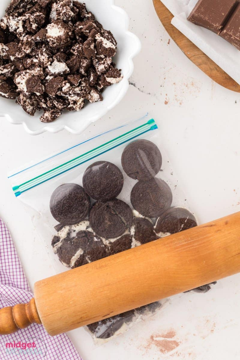 Oreo Cookies being crush in a zip close bag with a rolling pin