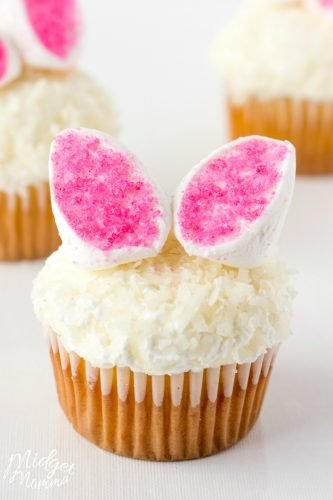 Easter Bunny Ears Cupcakes - MidgetMomma - These cute bunny ear cupcakes will make any one smile. They have a simple flavor with the addition of coconut and marshmallows.