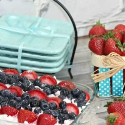 Strawberry Blueberry Dessert Lasagna is one of our favorite summer no bake desserts. This easy summer dessert is a refreshing treat that everyone will love. Also known as an Ice Box Cake, this easy to make dessert is perfect for BBQs, picnics, Memorial Day, 4th of July and more. Layers of tasty goodness, topped with fresh fruit this no bake dessert lasagna is always a hit. #Strawberry #Blueberry #Cake #Iceboxcake #Summer #NoBake #Dessert #4thofJuly #BBQ #Picnic