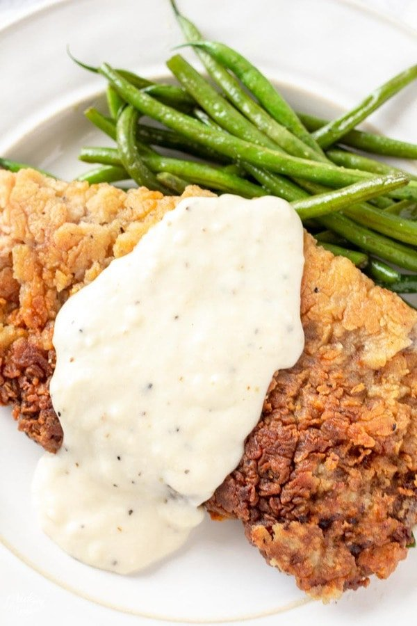 Chicken Fried Steak with white gravy and green beans