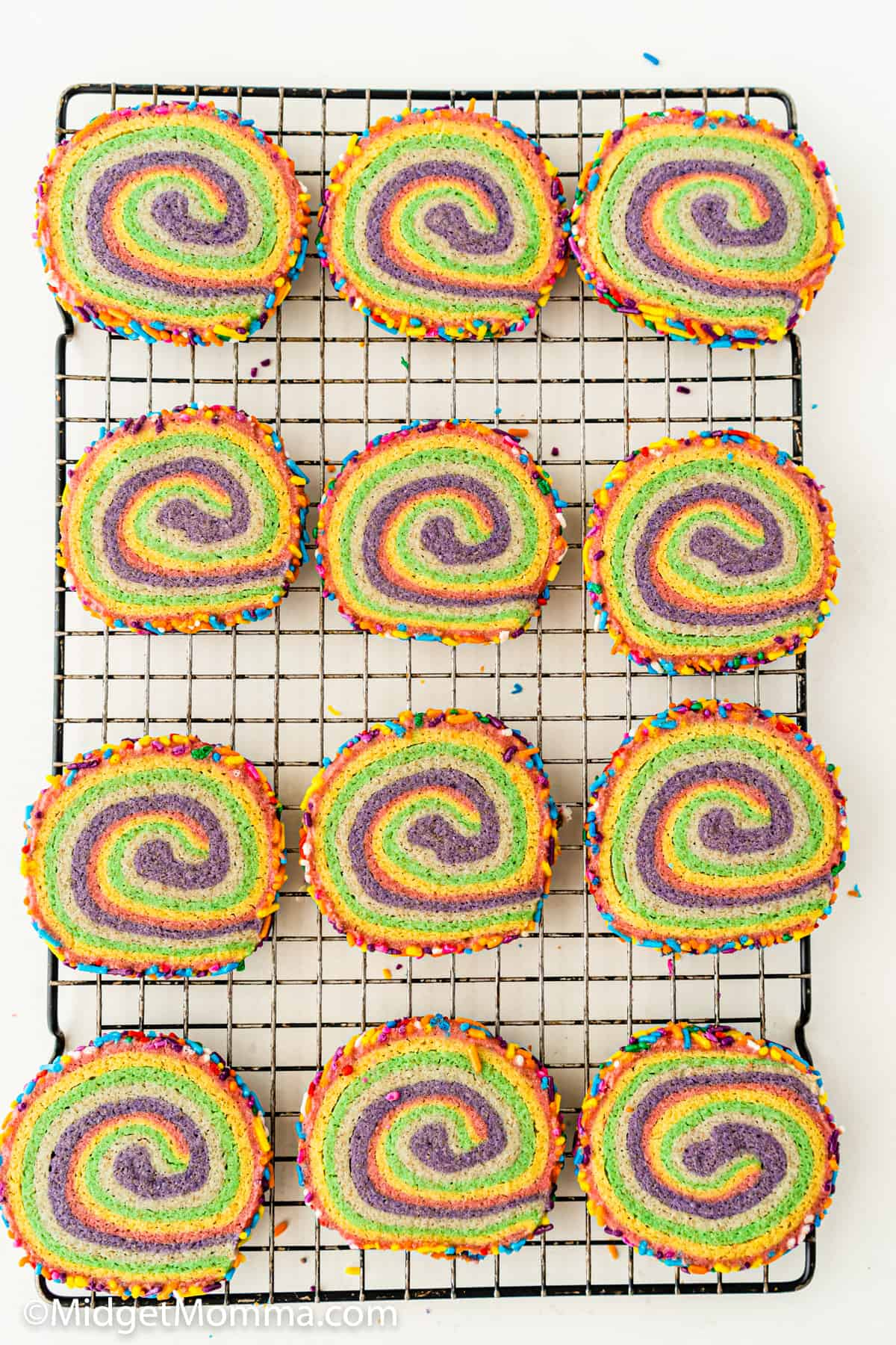 Rainbow Pinwheel Cookies Recipe on a cooling rack