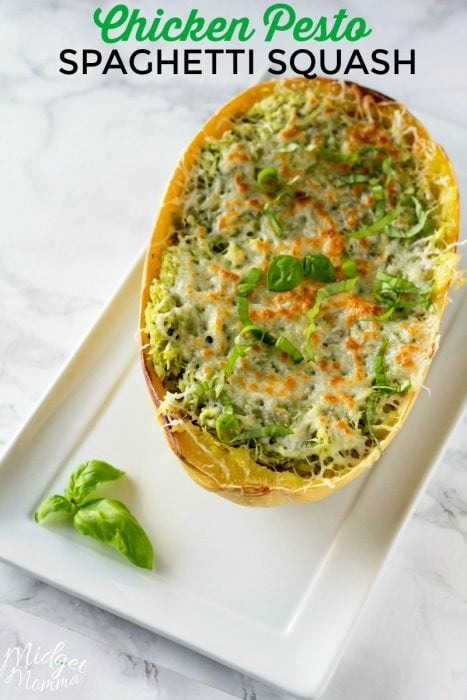 This Chicken Pesto Spaghetti Squash is an oven baked spaghetti squash recipe that is bursting with flavor. Chicken and Pesto combine for a flavorful spaghetti squash recipe that everyone will enjoy. #Chicken #SpaghettiSquash #Pesto #BakedSpaghettiSquash #Dinner #SpaghettiSquashRecipe #ChickenSpaghettiSquash