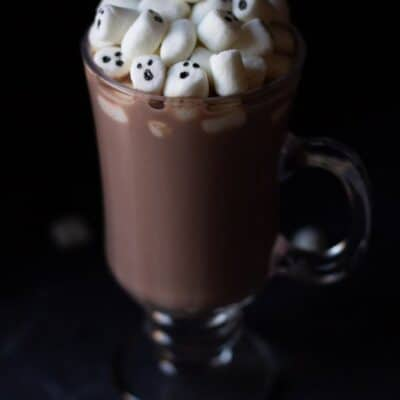 Marshmallow Ghosts in a glass of homemade hot chocolate