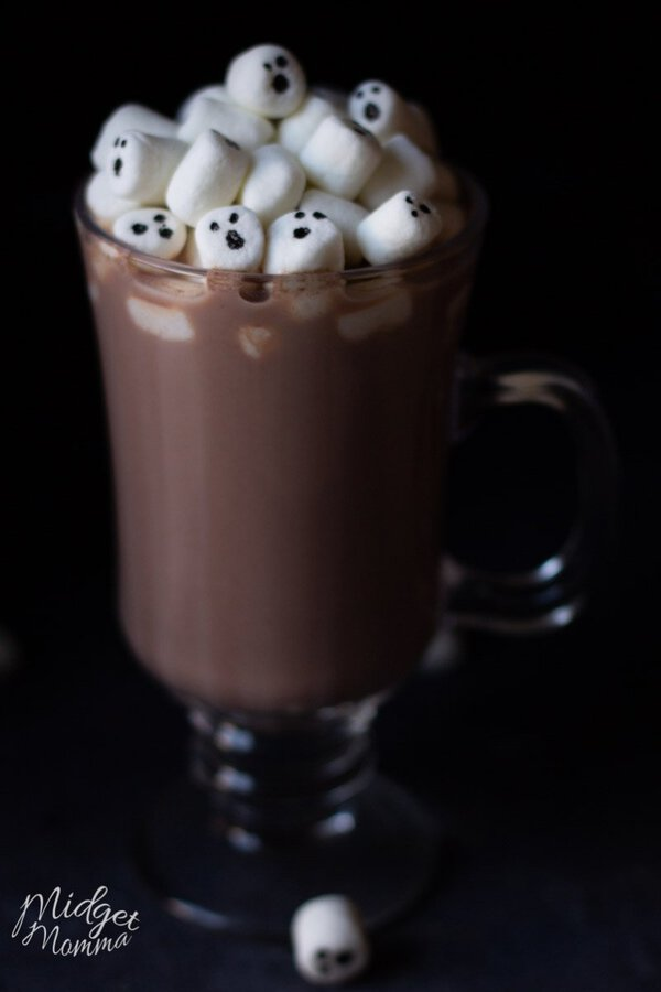 marshmallows with ghosts face in a glass of homemade halloween hot chocolate