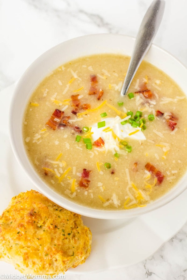 Potato Cauliflower Soup Recipe in a bowl with a cheddar biscuit