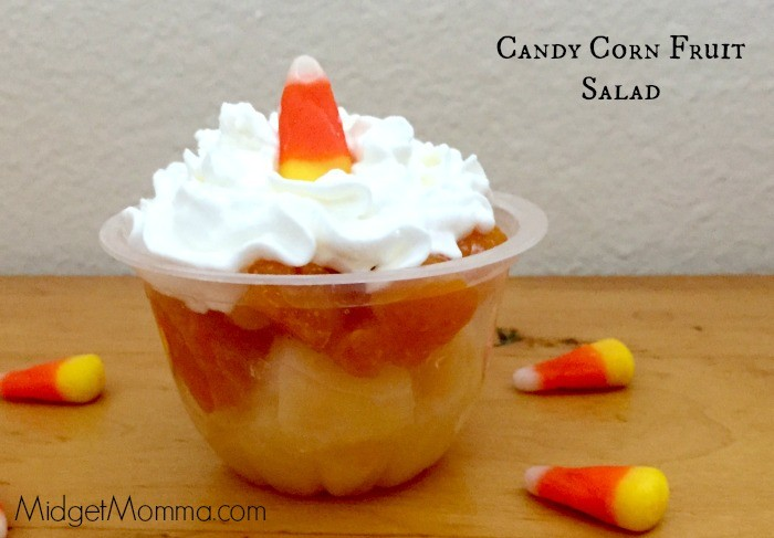 Candy Corn Fruit Salad. Halloween fruit treat treat layered to look like a candy corn. Using oranges, pineapple and whipped cream topped with candy corn