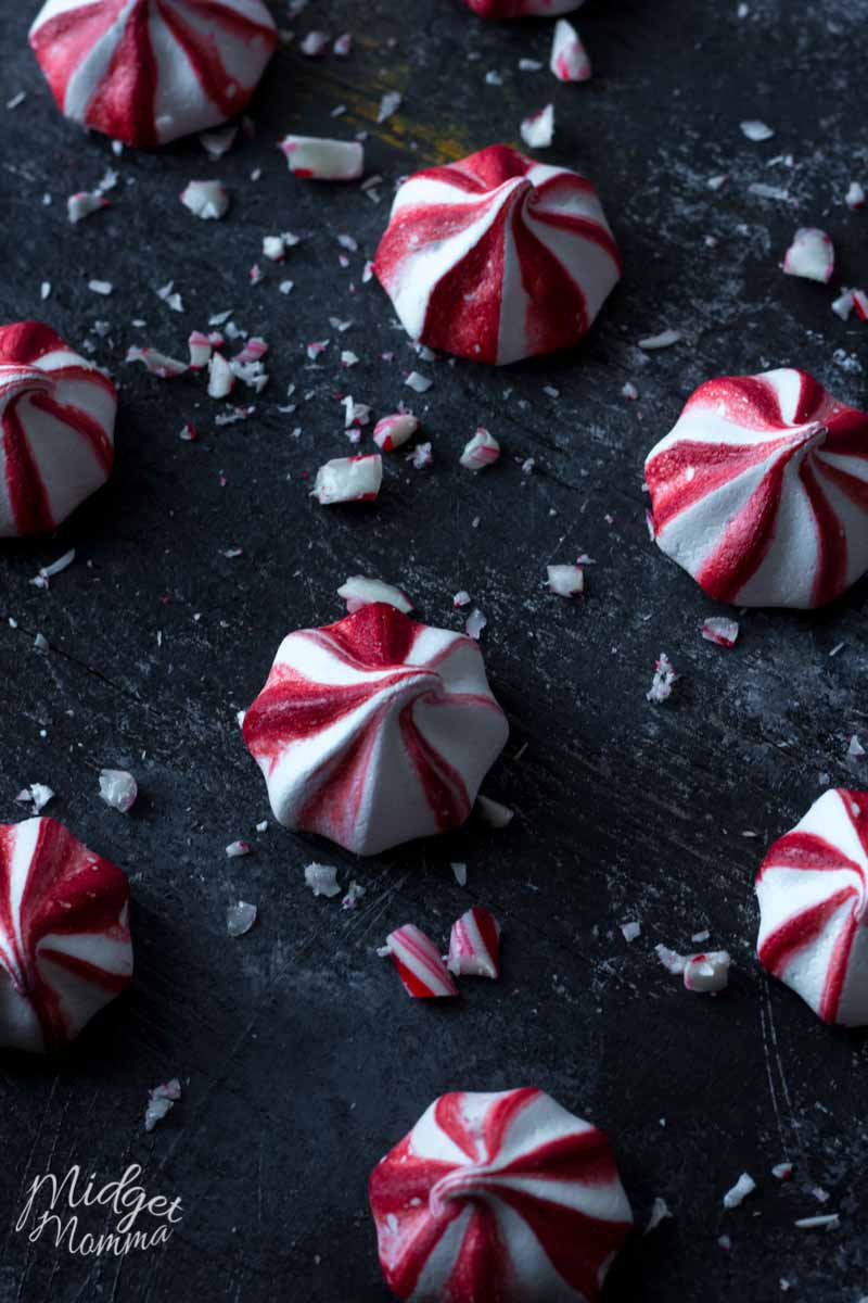 Peppermint Meringue cookies on a black background