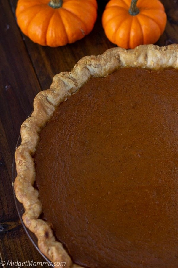 fresh baked maple pumpkin pie cooling on the counter