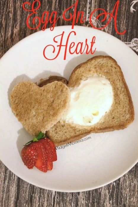 Egg In A Heart. A fun twist on your traditional egg in a hole, but so much more fun because it has a heart. A fun one for Valentine's Day or just because.