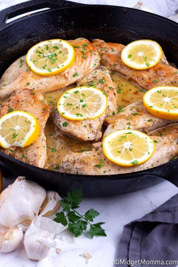 Lemon and garlic chicken in a black skillet