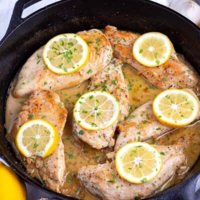 Lemon Garlic Chicken Recipe cooked in a black skillet on the counter