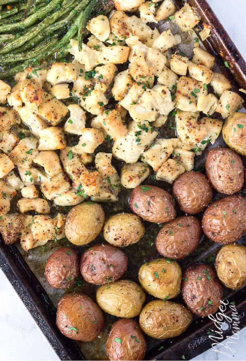 oven baked chicken and potatoes recipe on a baking sheet