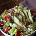 Avocado BLT Salad Recipe with dressing being poured on top