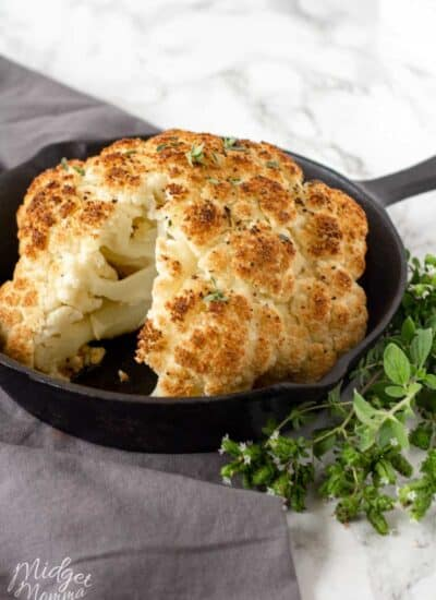 Whole roasted cauliflower in a baking pan