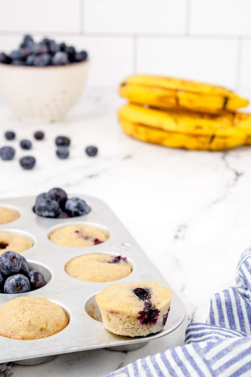 muffin tin with mini blueberry banana muffins