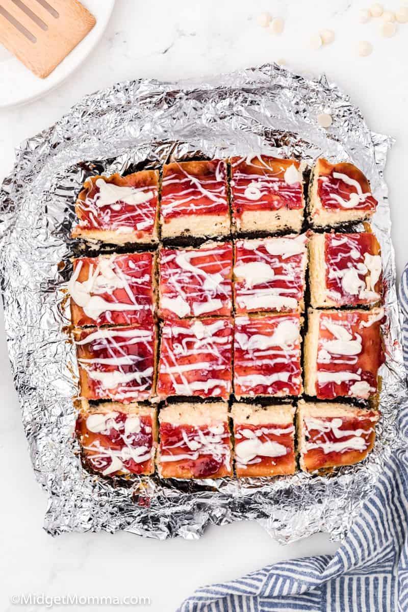 Strawberry White Chocolate Cheesecake Bars in a baking pan